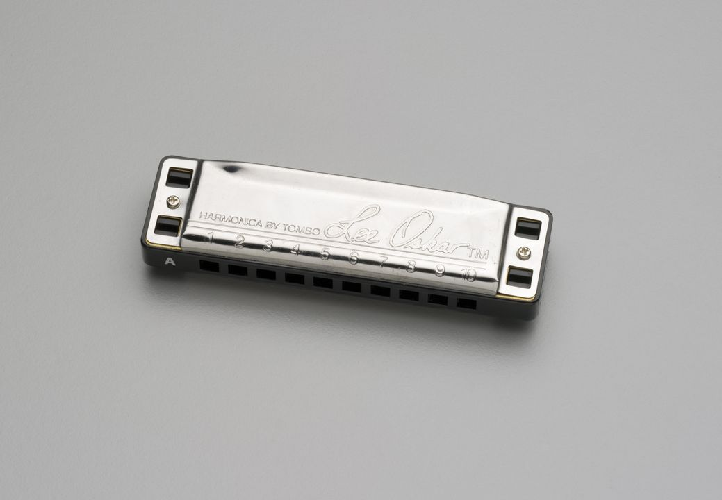 2007/216/1 Harmonica (mouth organ), 'Lee Oskar', steel / brass / plastic, made by Tombo, Japan, used by Paul Kelly, Australia, 2000-2001. Click to enlarge.
