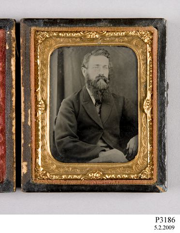 P3186 Photograph, ambrotype in case, studio portrait of unidentified man, collodion / paint / glass / wood / paper / metal / velvet, photographer unknown, place of production unknown, 1865-1880