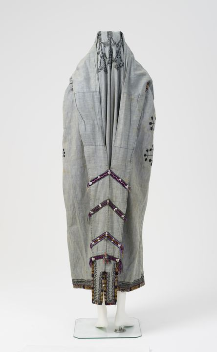 2003/176/2 Veiling garment (paranja), womens, embroidered cotton/ metallic ornaments/ buttons, made by Tajik woman in Russian Turkestan, c. 1900. Click to enlarge.
