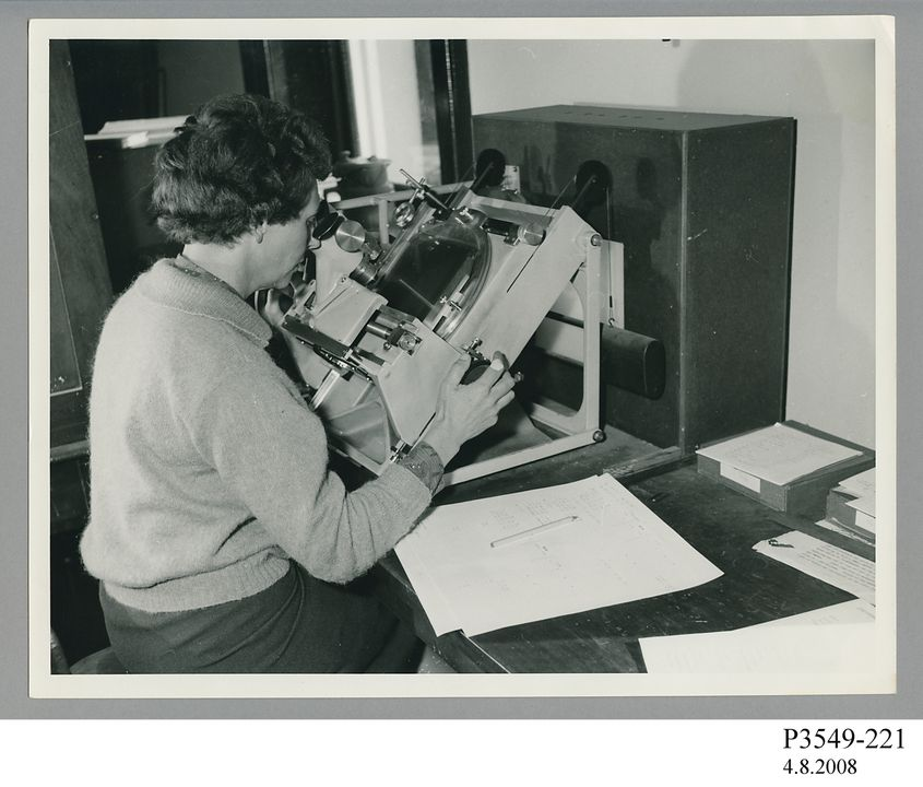 P3549-221 Photograph, black and white print, woman using plate measuring machine, paper, photographer unknown, used by Sydney Observatory, Sydney, New South Wales, Australia, 1960-1979. Click to enlarge.