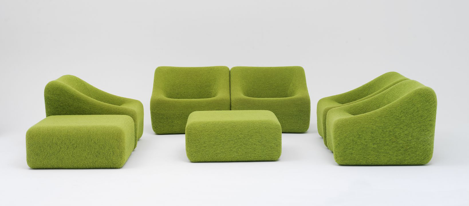 2012/125/1 Lounge suite, 'Numero IV', chairs (5) and ottomans (2), polyurethane foam / ABS plastic / wool, designed by Grant and Mary Featherston, made by Uniroyal Pty Ltd, Melbourne, Victoria, Australia, 1973-1974. Click to enlarge.