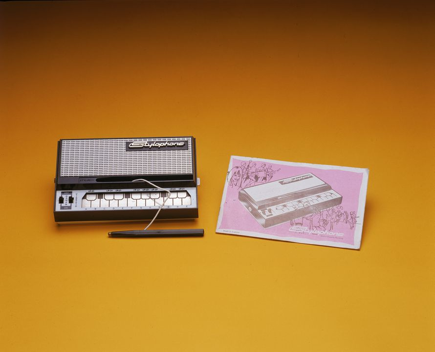 2000/135/1 Stylophone electronic musical instrument and instruction booklet, metal / plastic / paper, Dubreq Studios Limited, London, England, c. 1970. Click to enlarge.