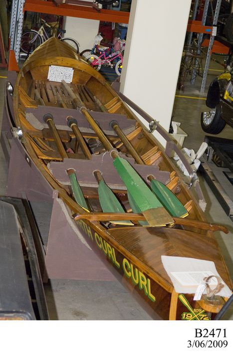 B2471 Surfboat, 'Nola Hubbard', wood / metal / leather made by Bill Clymer, Newport, New South Wales, Australia, 1972, used by North Curl Curl Surf Life Saving Club, North Curl Curl, New South Wales, Australia, 1972-1982. Click to enlarge.