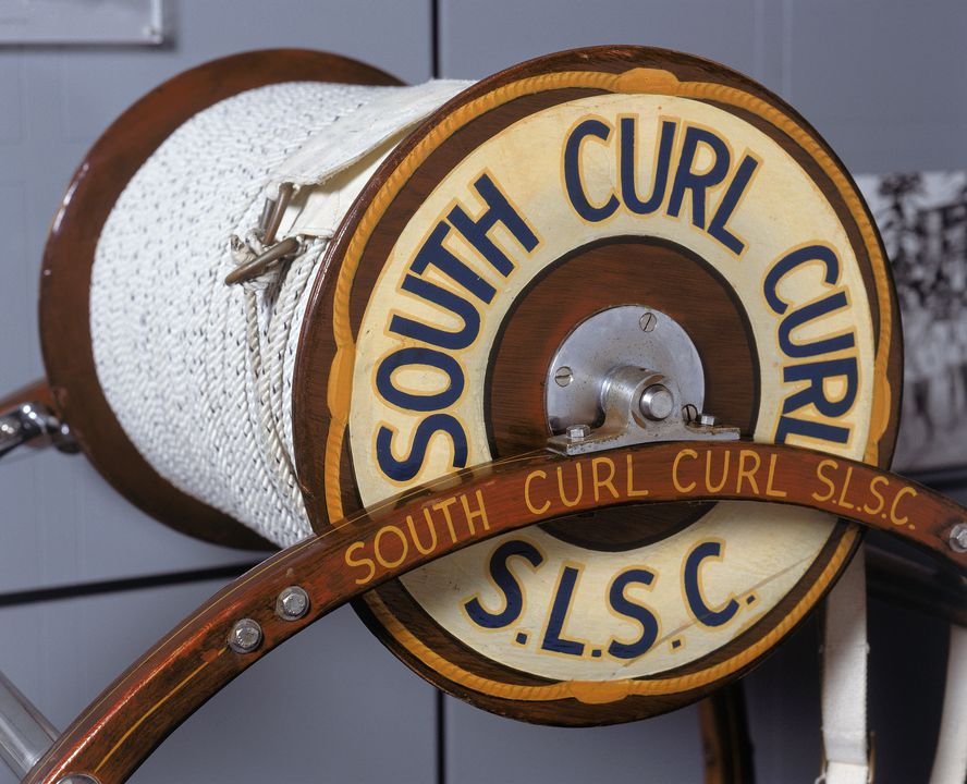 85/826 Surf lifesaving reel, wooden, used by South Curl Curl Surf Life Saving Club, Curl Curl, New Sout Wales, Australia, c. 1960. Click to enlarge.