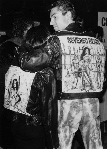 2003/147/1-2/6/1/2 Photographic print, black and white, man wearing 'Severed Heads' jacket, at the (RAT) Recreational Arts Team's 'Back to RAT' RAT Party, William Yang, Sydney, New South Wales, Australia, 1989