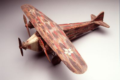 98/14/1 Toy aircraft, representing Fokker trimotor 'Southern Cross' flown by Charles Kingsford Smith and Charles Ulm, wood/metal, unknown designer/manufacturer, Australia, 1928-1929, used by William Swinbourne