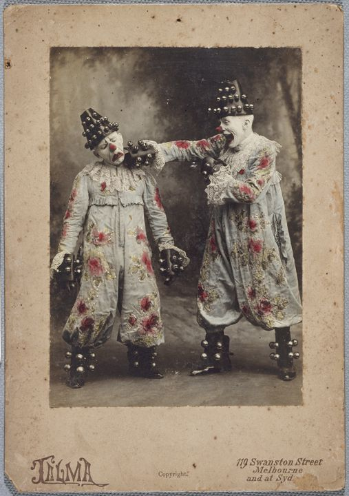 95/28/208 Photographic print, gelatin print, hand tinted, mounted on card, two clowns, Guillaume and one of his sons, performing the boxing bells act, Talma, Melbourne, Australia, c 1903. Click to enlarge.