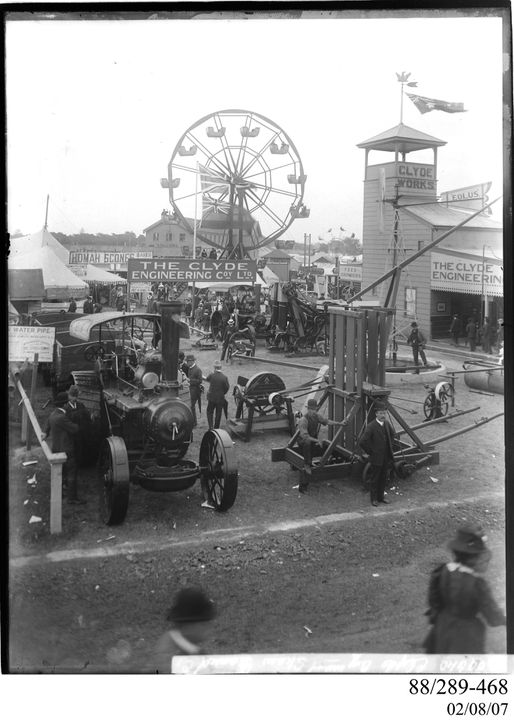 88/289-468 Photographic glass plate negative, Clyde Pavilion Royal Easter Show, traction engines and ferris wheel near Clyde display, Clyde Engineering Pty Ltd, Australia, 1898-1909. Click to enlarge.