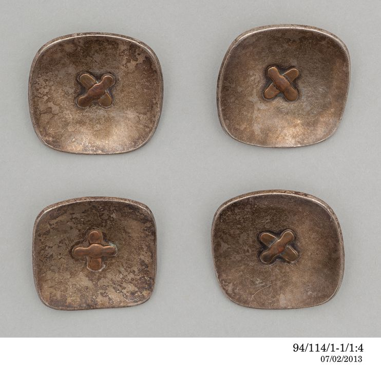 94/114/1-1 Collection of buttons (4), concave with central cross motif, metal, designed and made by Gordon Andrews, Sydney, New South Wales, Australia, 1945-1949. Click to enlarge.