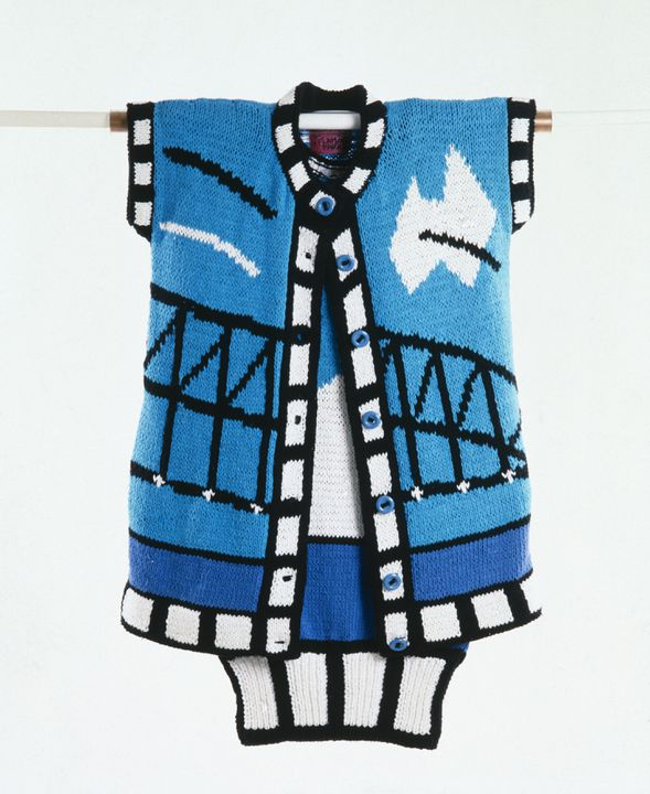 A7527-2 Coat, part of womens ensemble, knitted cotton, featuring the Sydney Harbour Bridge, designed by Jenny Kee, made by Jan Ayres for Flamingo Park, Sydney, Australia, 1980. Click to enlarge.
