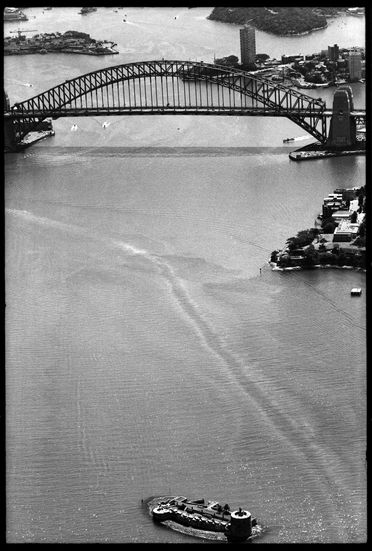 96/44/1-5/5/20/1 Negative, black and white, aerial view of Sydney Harbour showing Fort Denison to the Harbour Bridge , for photograph in the book 'Sydney. A Book of Photographs', but unused, 35mm acetate film, David Mist, Sydney, New South Wales, Australia, 1969