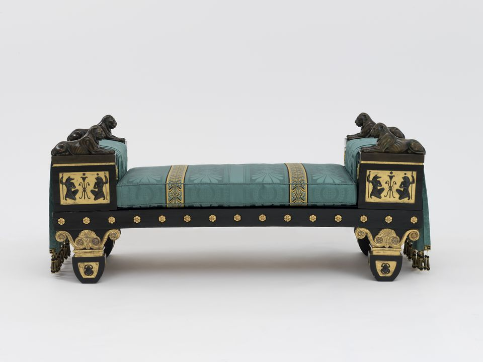 87/592 Settee, Regency Egyptian Revival style, ebonised and gilt beech / bronze and gilt brass mounts / reproduction silk damask and trimmings, designed by Thomas Hope, England, c. 1802. Click to enlarge.