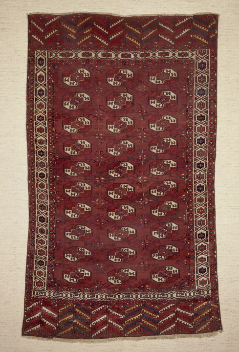 2015/26/2 Main carpet (khali), symmetrically knotted wool pile, made by Yomut Turkmen woman, Turkmenistan, late 1700s to early 1800s. Click to enlarge.