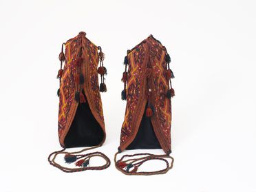2000/114/1 Pair of tent strut holders (ok bash), wool, supplementary weft, made and used by the Ersari Turkmen people, northern Afghanistan, 1900-1950