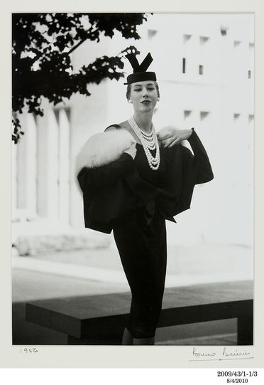 2009/43/1-1/3 Photographic print, black and white, model Diane Masters wears a Hall Ludlow black suit with pill box hat, location Melbourne University, photograph by Bruno Benini, Melbourne, Victoria, Australia, 1956