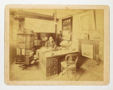 95/239/23 Photographic print, mounted on card, interior of the Government Astronomer's Office with H. C. Russell at his desk, paper / albumen emulsion, photographer Charles Bayliss, Sydney, New South Wales, Australia, 1890-1900
