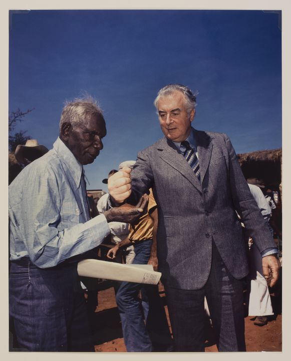 2004/52/1 Photograph, colour print, 'Gough Whitlam pouring soil into the hands of traditional owner Vincent Lingiari', paper, photographed by Mervyn Bishop, Northern Territory, Australia, 1975, printed in Australia, 2000. Click to enlarge.