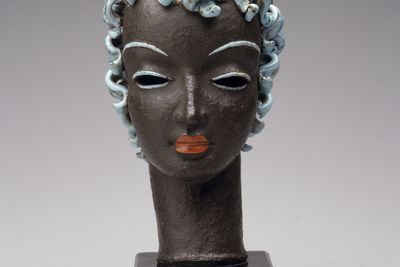 2005/66/10 Sculpture, woman's head, terracotta with hand-painted details / wood / metal, probably modelled by Rudolf Knoerlein, made by the Goldscheider Porcelain Works and Majolica Factory, Vienna, Austria, 1925-1930