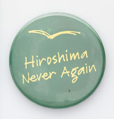 2007/176/1-6 Badge (1 of 7), 'Hiroshima Never Again', metal / plastic / paper, maker unknown, Sydney, New South Wales, Australia, 1970-1990