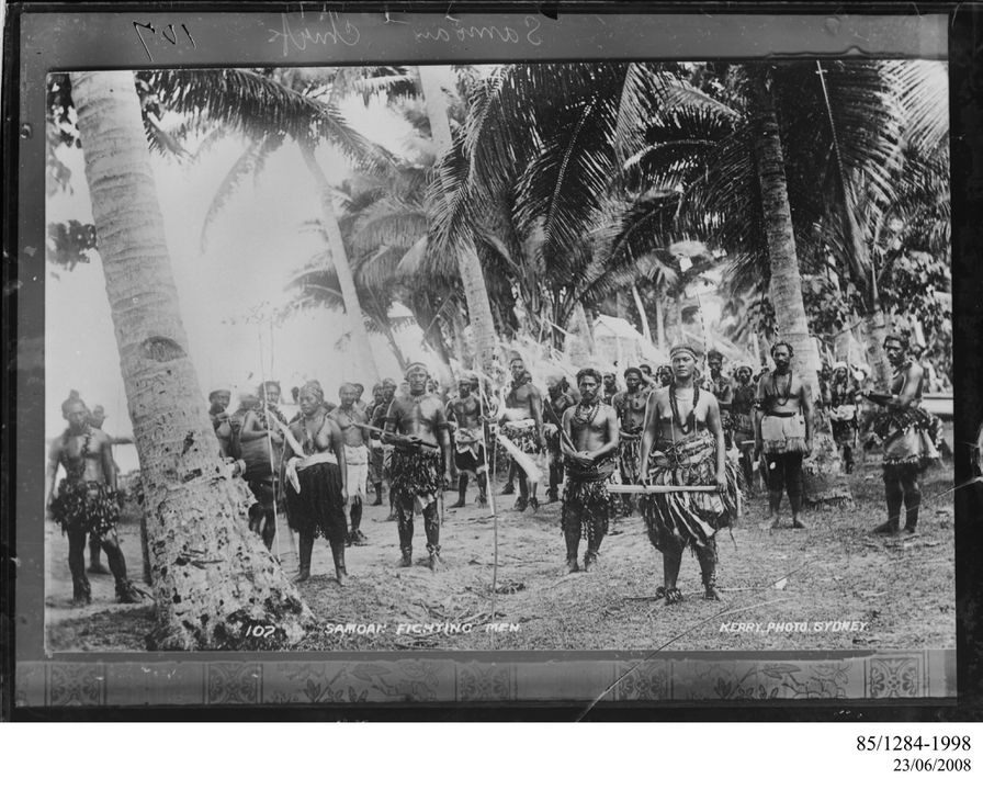 85/1284-1998 Photographic negative, copy from an original positive print, Samoan fighting men and two women, gelatin / glass, photographer unknown, published by Kerry and Co., Upolu, Samoa, 1899. Click to enlarge.