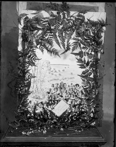2008/165/1-154 Glass plate negative (1 of 193), photograph of large Christmas card on wooden stand, glass, photographer possibly Arthur Phillips, Australia, c. 1895-1905
