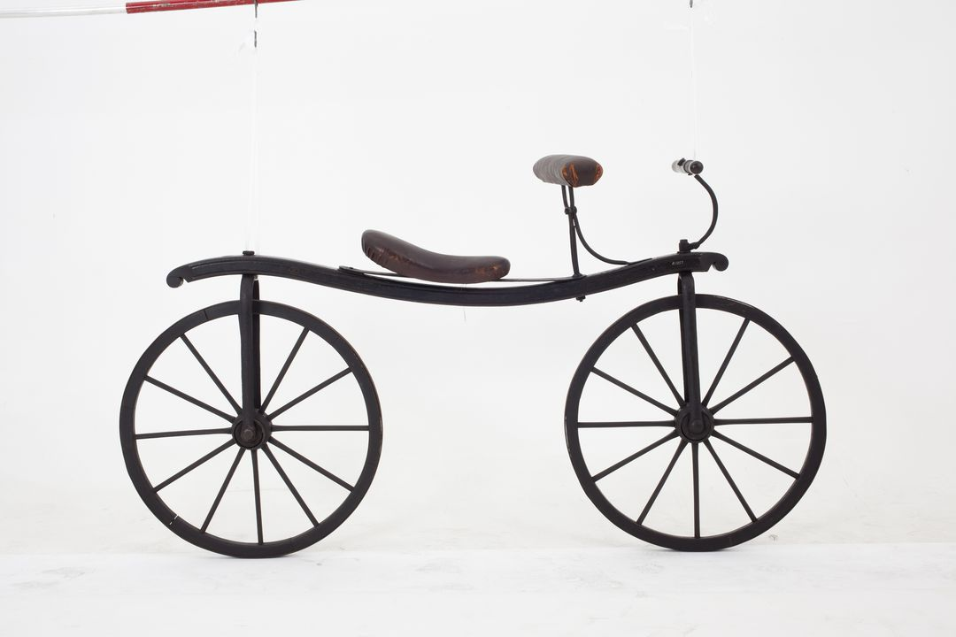 B1257 Bicycle, reproduction, Draisine or 'hobby horse', timber / metal, maker unknown, before 1954. Click to enlarge.