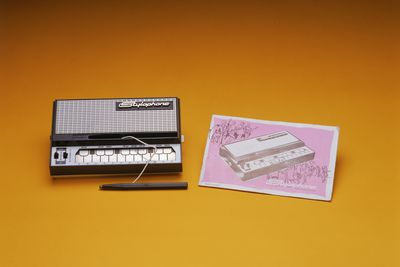 2000/135/1 Stylophone electronic musical instrument and instruction booklet, metal / plastic / paper, made by Dubreq Studios Limited, London, England, c. 1970