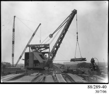 88/289-40 Photographic glass plate negative, depicting a standard gauge, 3-ton, diesel-electric railway crane, possibly built by A.T. Harmon & Son, Port Melbourne, Victoria, Australia, being used at Clyde Engineering Pty Ltd works, Granville, New South Wales, Australia, 5 January 1942