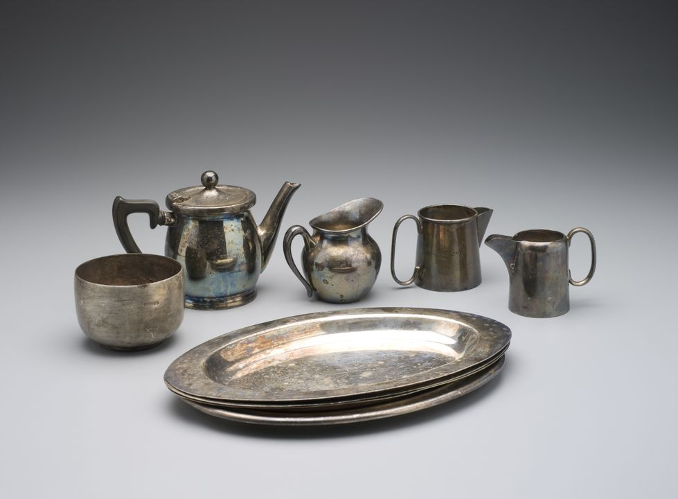 2007/106/11 Tea set, consisting of a teapot, sugar bowl, milk jugs (3), trays (4), electroplated nickel silver / metal / Bakelite, used by Repin's Coffee Inn, Sydney, New South Wales, Australia, 1933-1970, Reproduction Sheffied Plate made by Angus & Coote Ltd, Sydney, Australia, 1930 - 1940. Click to enlarge.