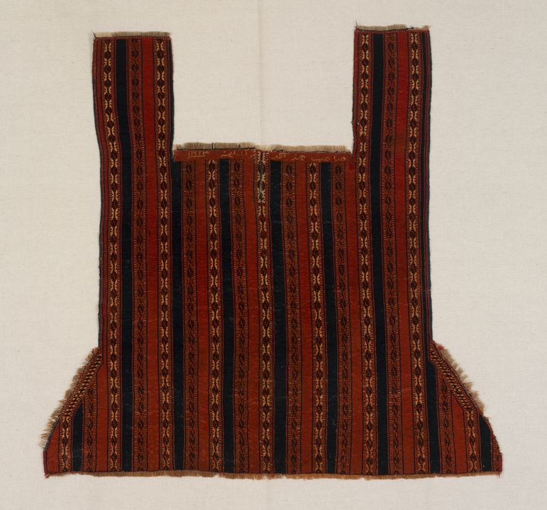2000/67/1 Horse cover, knotted pile weave, wool, made by a Tekke Turkmen woman, Western or Russian Turkestan, 1886 (1302 AH). Click to enlarge.