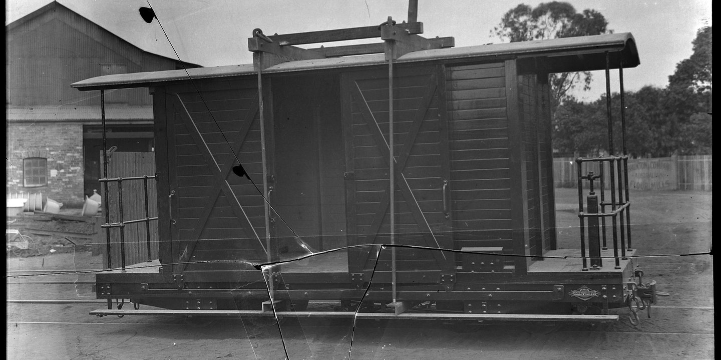 88/289-2 Photographic glass plate negative, depicting the narrow gauge, bogie, railway goods van, No. 4, built by Clyde Engineering Pty Ltd, Granville, New South Wales, Australia, 1914, for Colonial Sugar Refinery Co., used on Rarawai to Kavanagasau Light Railway, Fiji, 1914-1969. Click to enlarge.