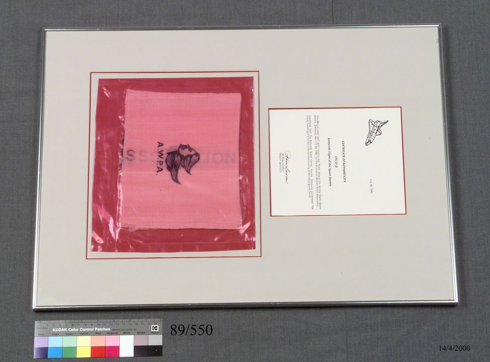 89/550 Framed scarf and certificate, made by Australian Wool Corporation, used by Margaret 'Rhea' Seddon, Australia, 1985. Click to enlarge.