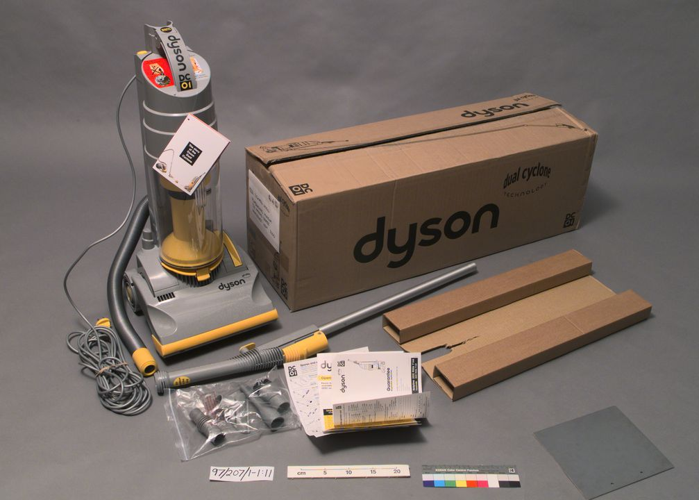 97/207/1 Vacuum cleaner in box, with leaflets and accessories, Dyson DC01 Dual Cyclone, plastic/paper/metal, Dyson Appliances, Malmesbury, England, United Kingdom, 1996. Click to enlarge.