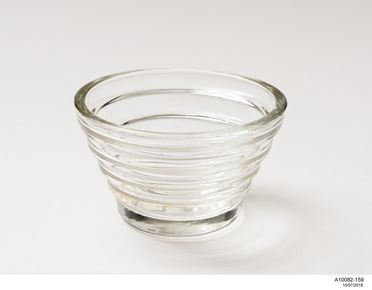 A10082-159 Jelly mould, ridged / tapered sides, quatrefoil moulded on base, glass, made by Crown Crystal Glass Company / Australian Glass Manufacturers, Waterloo, New South Wales / Melbourne, Victoria, Australia, 1926