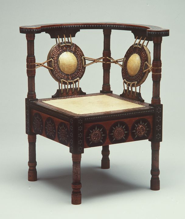 A9287 Chair, corner, wood and vellum inlaid in ebony, pewter and brass, designed by Carlo Bugatti, Milan, Italy, made by an unknown maker, c. 1895-1900. Click to enlarge.