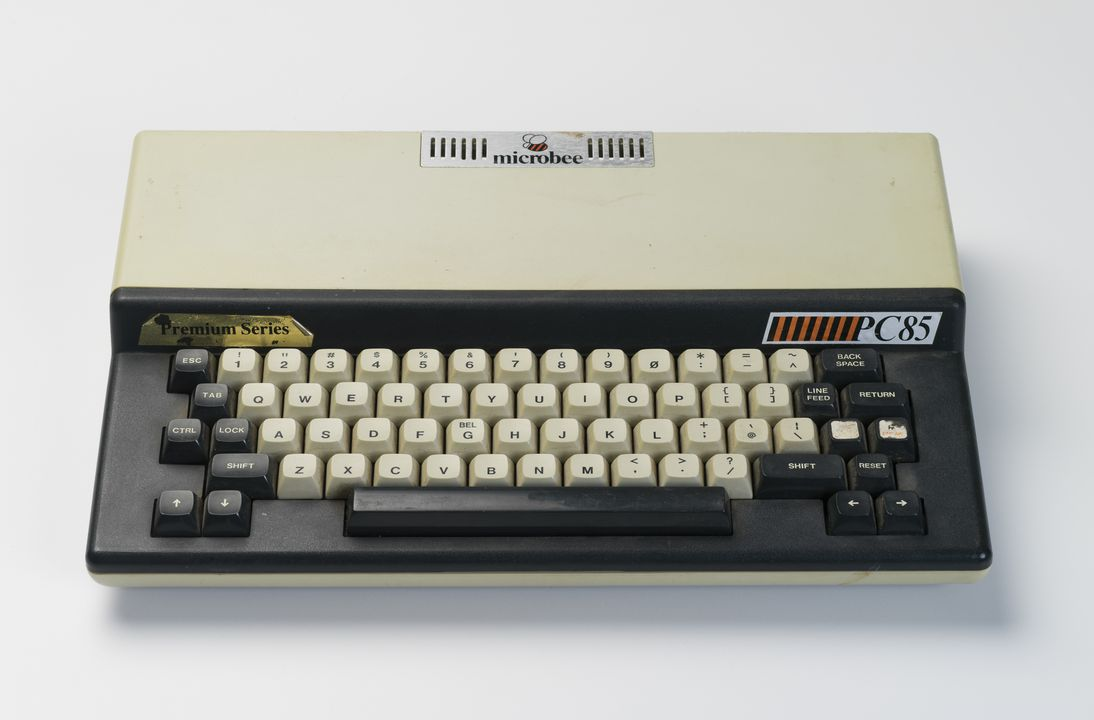 2013/94/1 Computer, and circuit board, for Microbee PC85, plastic / metal / electronic components, made by Microbee Systems, Gosford, New South Wales, Australia, 1985. Click to enlarge.