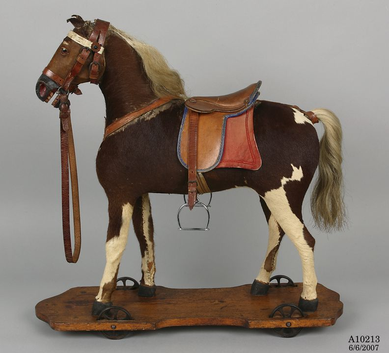 A10213 Toy horse, pull along, wood / leather / metal / [calf skin] / [cow's tail hair], probably manufactured in Germany, 1875-1899. Click to enlarge.