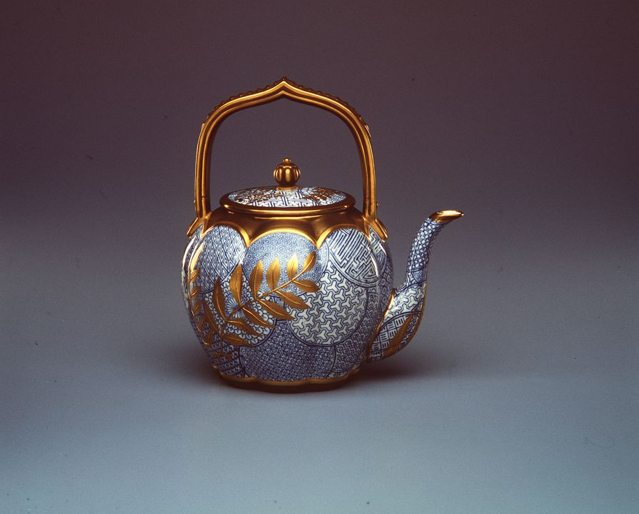 154 Teapot, porcelain, blue overglaze enamel and applied gilding in Japonisme style, made by Royal Worcester Porcelain Company Limited, Worcester, England, 1880. Click to enlarge.