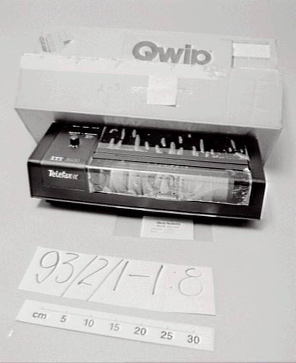 93/2/1 Facsimile machine with accessories and packaging, ITT 3500 Telefax Group 2, black casing, plastic / metal / paper , by Qwip Systems / Zephyr Products, United States of America / Australia, 1980 - 1982. Click to enlarge.