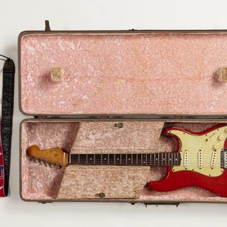 2019/43/1 Electric guitar with case and strap, Stratocaster, serial number 69250, wood / plastic / metal / electronic components, made by Fender, Fullerton, California, United States of America, 1961, used by Jim Skiathitis to write, record and perform the instrumental song 'Bombora' by The Atlantic