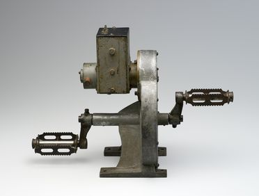 B2125 Pedal generator, brass / steel / paint, designed by Alfred Traeger, unknown maker, used by the Flying Doctor Service, Cloncurry area, Australia c 1930 - 1940