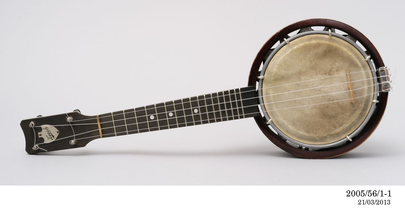 2005/56/1 Banjulele with case and plectrum, combination banjo and ukulele, timber / metal / aluminium / calfskin / nylon / cardboard / velvet / felt, made by Alvin D Keech, United States of America, 1918 - 1945. Click to enlarge.