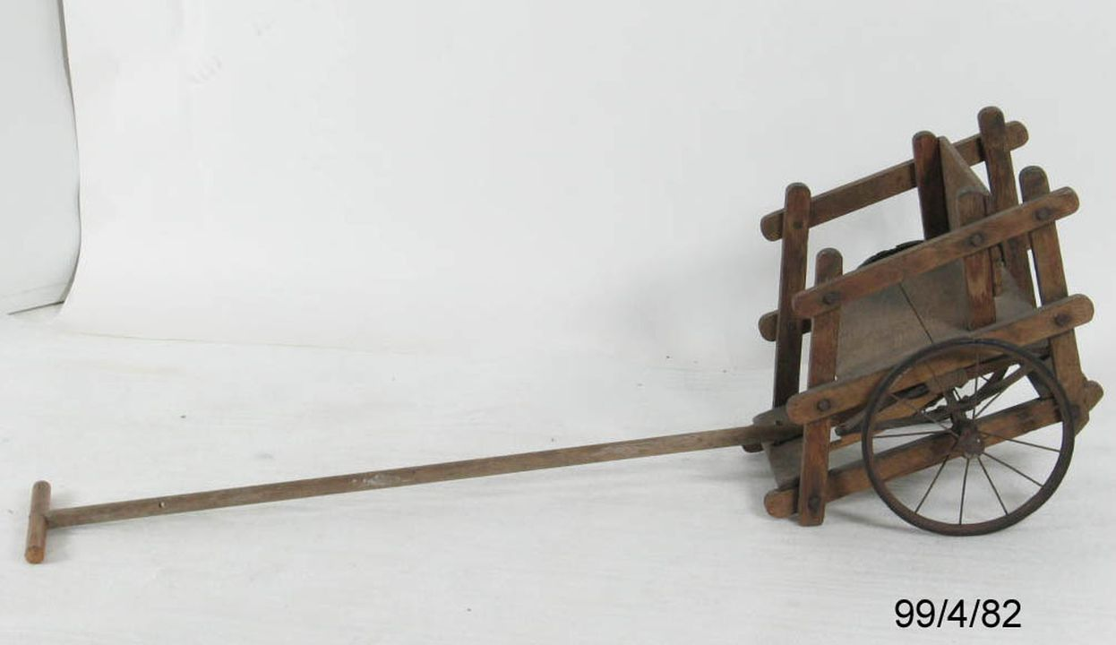 99/4/82 Child's chair cart, 'mail cart', wood/ metal/ rubber, Australia, 1890-1930. Click to enlarge.