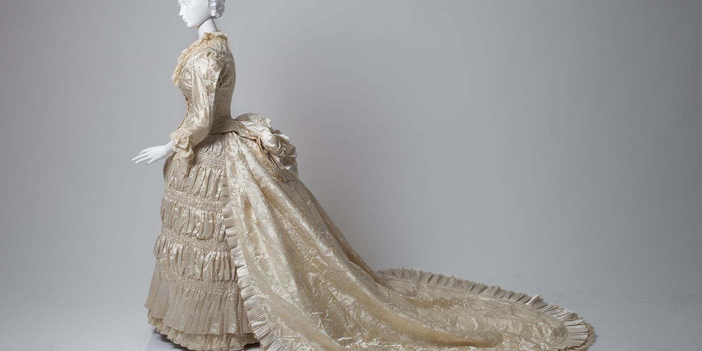 2015/29/1 Wedding ensemble, consisting of bodice, skirt, train and cape, women's, silk / satin / lace / cotton / wool, made by Farmer & Co, Sydney, New South Wales, Australia, c. 1885. Click to enlarge.