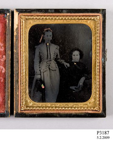 P3187 Photograph, studio portrait, hand-painted ambrotype of two unidentified women, collodion / paint / glass / wood / paper / metal / velvet, photographer unknown, place of production unknown, 1865-1870
