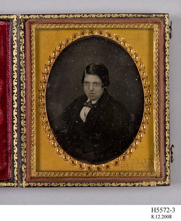 H5572-3 Daguerreotype, embossed case, studio portrait of James Allpress, collodion / paint / glass / wood / paper / brass / velvet / leather, James Gow, Sydney, New South Wales, Australia, 1858. Click to enlarge.