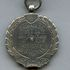 Image 2 of 2, N18092 Medal, 1904 NSW ASA Championship 440 yards, silver, made by William Kerr, won by Barney Kieran, Sydney, New South Wales, Australia, 1904. Click to enlarge