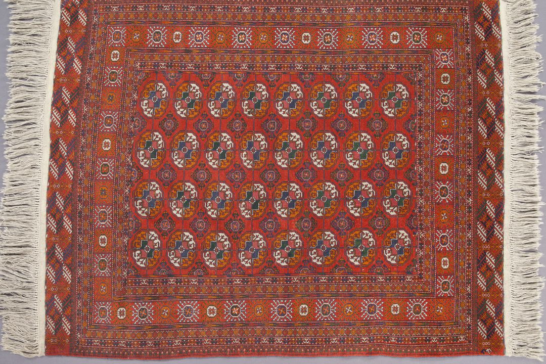 A4376 Rug, knotted pile, wool, Tekke Turkmen design, probably made in Bukhara, Uzbekistan (formerly part of the USSR), c.1950. Click to enlarge.