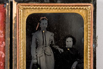 P3187 Photographic positive, studio portrait, hand-painted ambrotype of two unidentified woman, collodion / paint / glass / wood / paper / metal / velvet, photographer unknown, 1865-1870