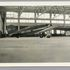 Image 1 of 2, 85/112-32 Photograph, black and white, Lady Southern Cross aircraft in hanger, paper, photographer unknown, Oakland, California, United States of America, 1934. Click to enlarge